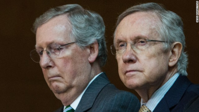 Sen. Mitch McConnell, left, said that if Harry Reid didn't back down from his threat, he would be the worst majority leader ever.