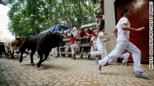 Thrill seekers race amid Miura\'s bulls during the last bull run of the San Fermin Festival in Pamplona, Spain, on Sunday.