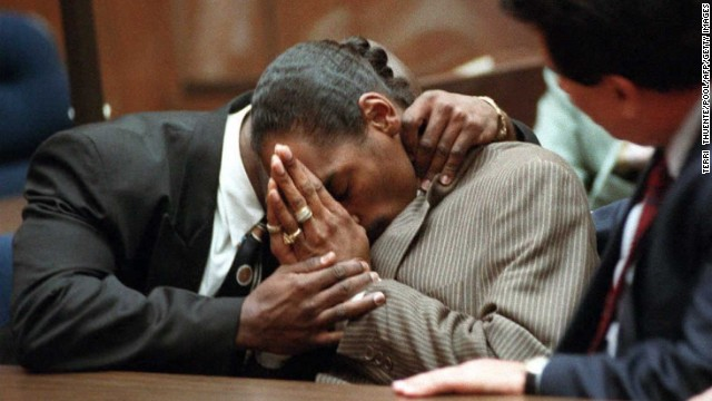 "Rapper <a href='http://www.cnn.com/US/9602/snoop/'>Snoop Dogg</a>, whose real name is Calvin Broadus, is embraced by his former bodyguard McKinley Lee in 1996 after they were both acquitted of murder charges in the shooting death of an alleged gang member. Ironically, a music video released before the trial for the song ""Murder Was the Case"" features Snoop as a man who kills someone in self-defense and is then convicted of murder."