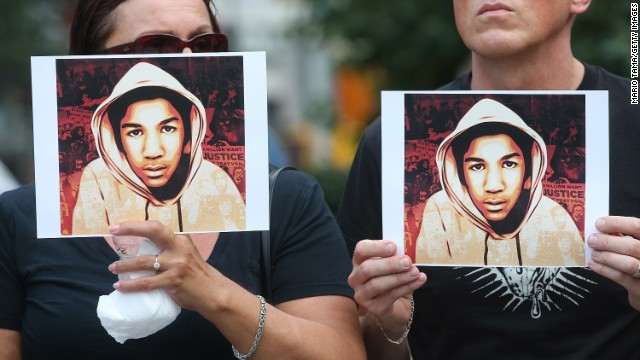 People hold photos of Trayvon Martin at a rally in Manhattan's Union Square on July 14.