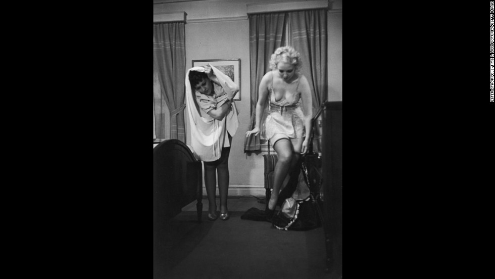 School of Undressing professor Connie Fonzlau, left, demonstrates the wrong way to disrobe, while burlesque star June St. Clair shows the correct way, during a class at the Allen Gilbert School of Undressing in New York in 1937. Classes cost $30 for six lessons, according to an article published in Life magazine.
