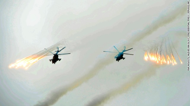 Russian Army helicopters fire flares over Sakhalin Island on July 16.