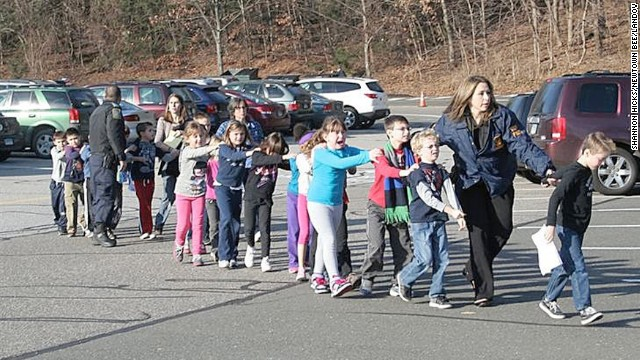 Connecticut State Police evacuate children from Sandy Hook Elementary School in Newtown, Connecticut, on December 14, 2012. Adam Lanza opened fire in the school, killing 20 children and six adults before killing himself. Police say he also shot and killed his mother in her Newtown home.