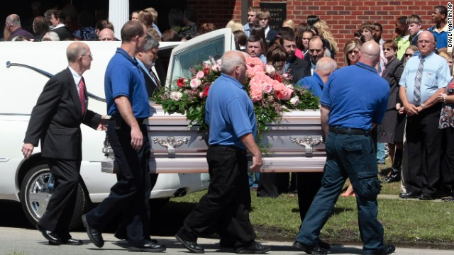 "Pallbearers carry a casket of one of Michael McLendon's 10 victims. McLendon shot and killed his mother in her Kingston, Alabama, home, before shooting his aunt, uncle, grandparents and five more people. He shot and killed himself in Samson, Alabama, on March 10, 2009. McClendon left a note saying he put his mother ""out of her misery."""
