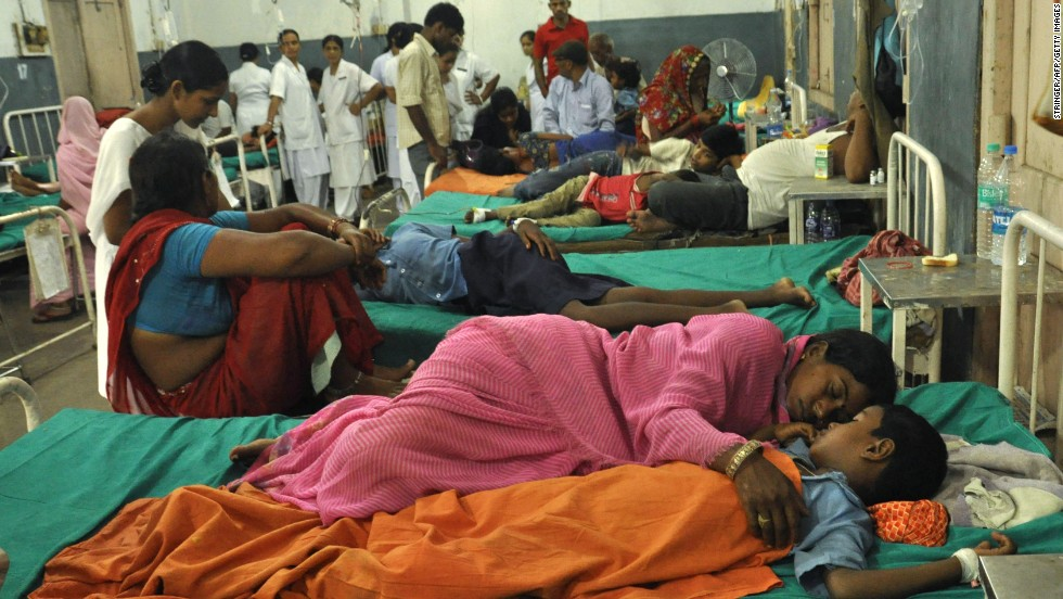 A woman rests with her child at a ward housing the poisoned schoolchildren at the Patna Medical College and Hospital, in the eastern Indian state of Bihar, Wednesday, July 17. At least 22 schoolchildren died in northeastern India after eating free school lunches that contained an insecticide commonly used in agriculture. Officials are investigating whether the poisoning was accidental or deliberate.