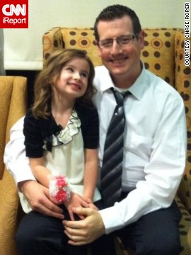 "Chase Roper, a comedy writer and full-time dad of four kids in Puyallup, Washington, poses with his daughter at a father-daughter dance. ""I realized that the way I provide for my family now is by being dad. Once I embraced that, I found my groove."" (<a href='http://ireport.cnn.com/docs/DOC-1006479'>Read his story.</a>)"