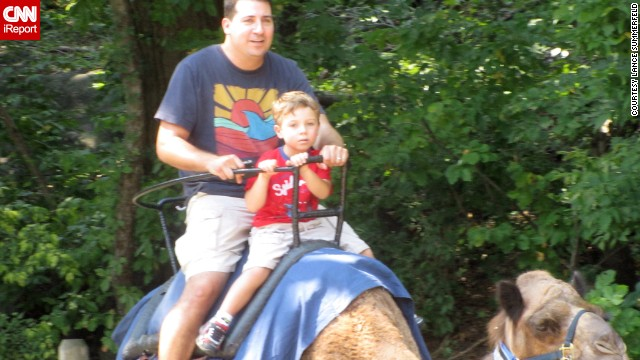 "Full-time dad Lance Somerfeld and his son, Jake, ride the camel at the Bronx Zoo, one of their favorite places to visit. Somerfeld says ""being an active, engaged, involved dad is a cool and rewarding thing to do."" His own father ""never changed a diaper in his life."" (<a href='http://ireport.cnn.com/docs/DOC-1006290'>Read his story.</a>)"