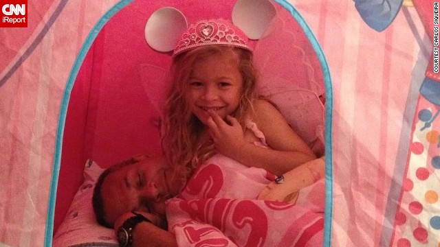 Even though IT consultant Carlos Siqueira works in another state, he tries to take an active role in his 6-year-old daughter's life. That includes sleeping in her Barbie tent. (<a href='http://ireport.cnn.com/docs/DOC-1005619'>Read his story.</a>)