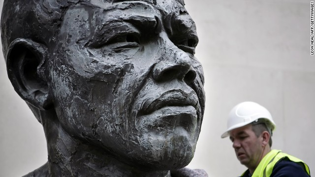 ENGLAND: A six-foot bronze sculpture of Mandela is lifted onto a platform in front of the Royal Festival Hall in central London. Cast in bronze, the sculpture was originally unveiled in 1985, five years before Mandela's release from prison.