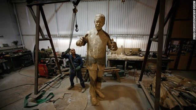 ENGLAND: A foundry worker moves a crane after lifting a new statue of Mandela in Braintree, northeast of London. The nine-foot high bronze statue was started by British sculptor Ian Walters, who died in 2006, and completed by Nigel Boonham. Weighing approximately one ton, the sculpture now stands on the corner of Parliament Square facing the Palace of Westminster.