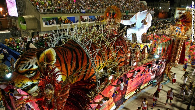 BRAZIL: A float by the Porto da Pedra samba school pays tribute to Mandela as it parades at the Sambadrome during the second night of Carnival celebrations in Rio de Janeiro.