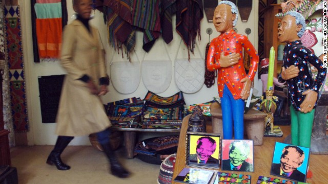 SOUTH AFRICA: Ceramic statues of Mandela are seen in a shop in Johannesburg.