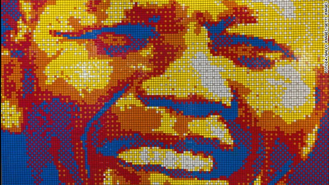 SOUTH AFRICA: A mosaic portrait of Mandela made entirely out of Rubik's cubes is on display at the entrance of the Mandela Rhodes Place Hotel & Spa in Cape Town. It was created by artist Jan Du Plessis.