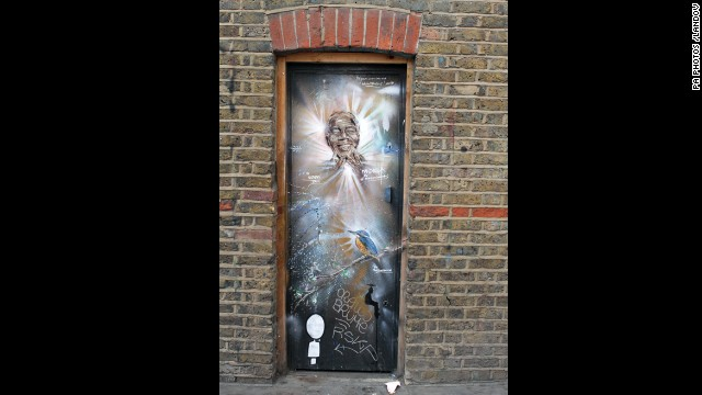 ENGLAND: Graffiti of Mandela by Paul Don Smith is seen on a door in East London.