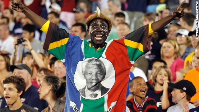 UNITED STATES: A fan wearing the colors of South Africa and a portrait of Mandela cheers in the second half of a soccer match between the U.S. and the Czech Republic in East Hartford, Connecticut.