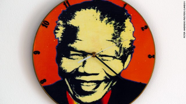POLAND: A clock in Warsaw is made out of an old vinyl record and painted with Mandela's headshot.
