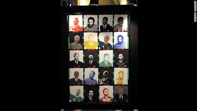 FRANCE: Artwork featuring Mandela over the years is on display at an exhibition in Paris.