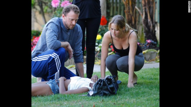 "Jennifer Lawrence isn't too ""Hollywood"" to help out a stranger. The Oscar-winning actress stayed by the side of a sick woman who was lying on the ground and in need of care in June 2012. Lawrence remained put until paramedics arrived on the scene in Santa Monica."
