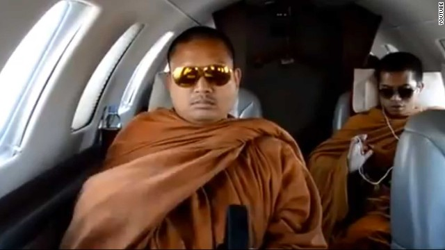 This still image taken from amateur footage posted on YouTube purportedly shows Luang Pu Nenkham (L) on a private jet.