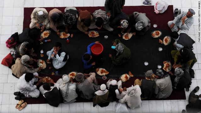 Men break their fast on July 17 at the Shrine of Hazrat Ali in Mazar-i-Sharif in northern Afghanistan.