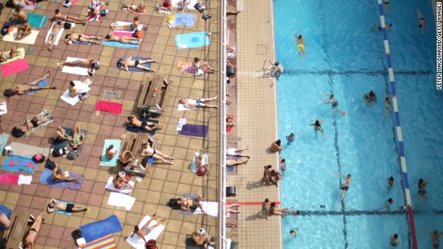 Swimmers enjoy the sunshine at an outdoor pool in central London on Wednesday, July 17.