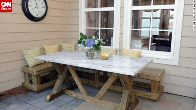 <a href='http://ireport.cnn.com/docs/DOC-1003865'>Rina Norwood</a> enjoys dining al fresco in the corner of her patio where she built a banquette and used salvage marble as a table top.