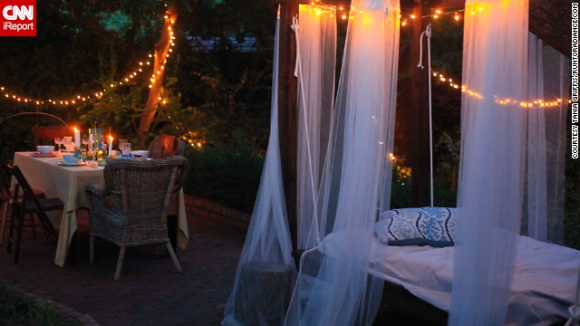 <a href='http://ireport.cnn.com/docs/DOC-1004709'>Tania Griffis</a>' swinging bed is her favorite spot in the backyard to curl up with a glass of wine and a good book at the end of the day.