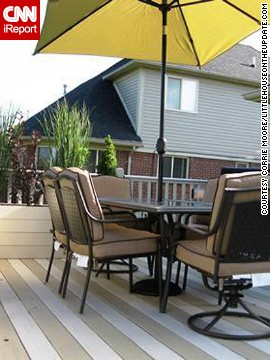 <a href='http://ireport.cnn.com/docs/DOC-1005429'>Corrie Moore</a> and her husband painted their deck boards in tan and cream stripes to give the illusion of a larger deck.