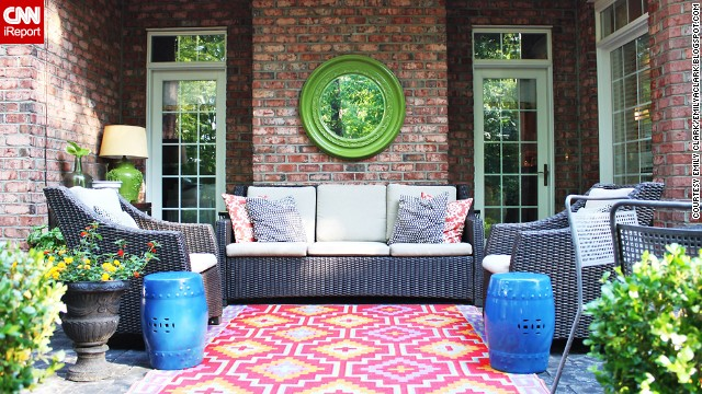 <a href='http://ireport.cnn.com/docs/DOC-1005402'>Emily Clark</a> livened up her patio with a colorful outdoor rug and spray painting a mirror and two garden stools.