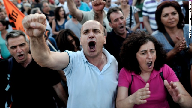Municipality employees demonstrate in front of the Greek Parliament during a vote on more austerity measures.