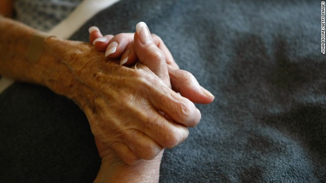 A terminally ill resident of a Colorado hospice is comforted. In hospice care, dying people are kept comfortable without extreme medical intervention.