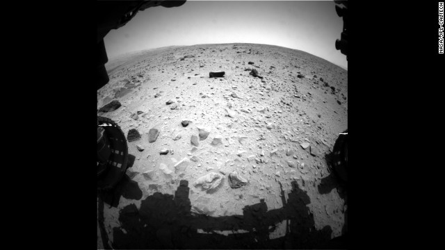 "The 2,000-pound rover Curiosity landed on Mars on August 6, 2012, and has been sending back fascinating images and data ever since. Curiosity recently began a trek toward Mount Sharp after spending more than six months in the ""Glenelg"" area. This image was taken on July 16, after the rover passed the 1 kilometer mark for the total distance covered since the start of the mission. It still has over 8 kilometers (5 miles) to cover before reaching Mount Sharp, which will take several months."