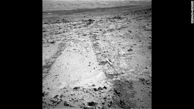"This image taken by the rover on Monday, July 8, shows the tracks left behind after its first drive away from the ""Glenelg"" area, covering roughly 60 feet."