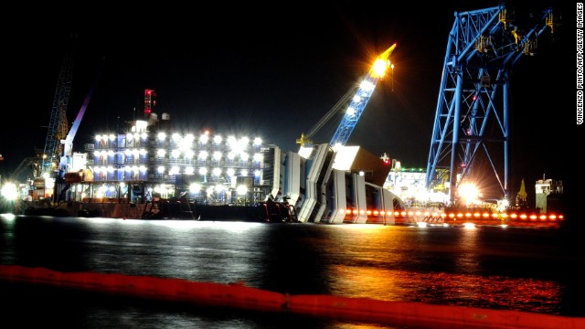 Salvage workers continue recovery operations at the site on June 15, 2013. Thirty-two people died in the tragedy and another 150 people were injured in the evacuation of the ship -- 65 of them seriously.