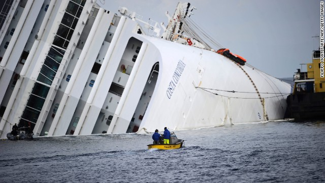 Workers head toward the stricken cruise ship on January 23, 2013.