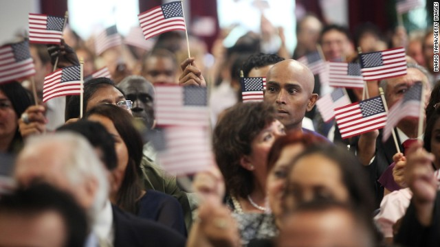 New Americans wave flags at a naturalization ceremony in Manhattan on July 2 in New York City.