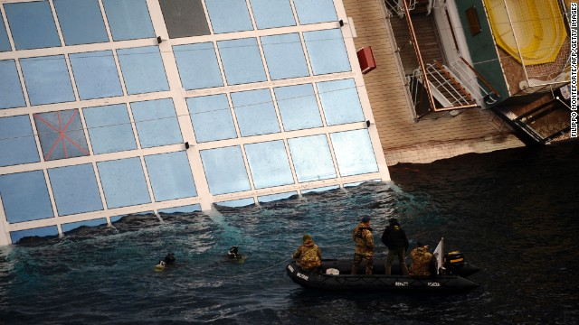 Divers inspect the Costa Concordia on January 15, 2012.
