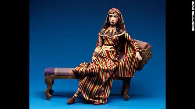 The museum's collection also includes set pieces, like the chaise that this puppet version of Cleopatra is reclining on.