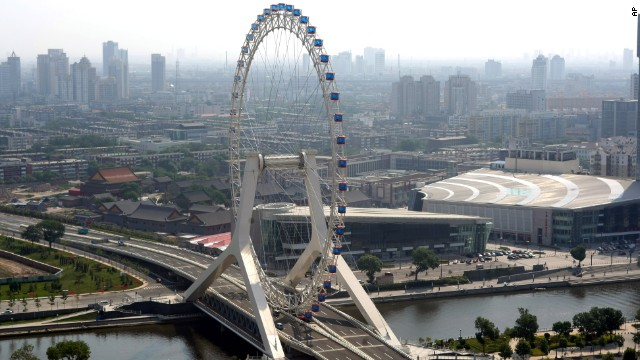 The Tianjin Eye, in its namesake city in northeastern China near Beijing, was built on a bridge across the Hai River. The wheel can hold 770 passengers in 48 capsules. Riders can get amazing views of the city and the cars on the highway below them during the 30-minute rotation.<!-- --> </br>