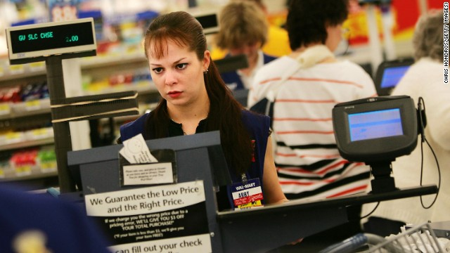 A cashier works the register at a Wal-Mart Supercenter. Nancy Pelosi and Rosa DeLauro say women and their families are struggling financially.