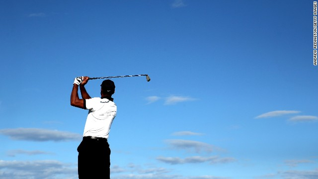 A solid back nine at Muirfield kept 14-time major winner Tiger Woods in the hunt on two under.
