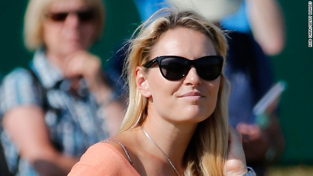 Mingling with the Muirfield crowd was Olympic champion skier Lindsey Vonn, who is keeping her beau Woods company in Scotland.