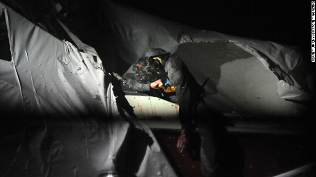 Tsarnaev exits the boat during his capture. The pictures were taken by Murphy and published online by Boston Magazine on July 18.