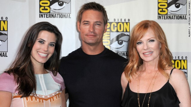 "Actors Meghan Ory, left, Josh Holloway and Marg Helgenberger speak onstage at the ""Intelligence"" panel at San Diego Convention Center on July 18. The sci-fi TV series is set to premiere in February."