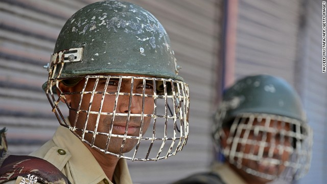 Indian paramilitary troopers stand alert during a curfew in Srinagar on July 19, 2013.