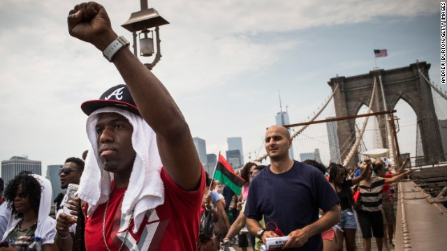 Protesters march across the Brooklyn Bridge toward Brooklyn after attending the rally in Manhattan on July 20.