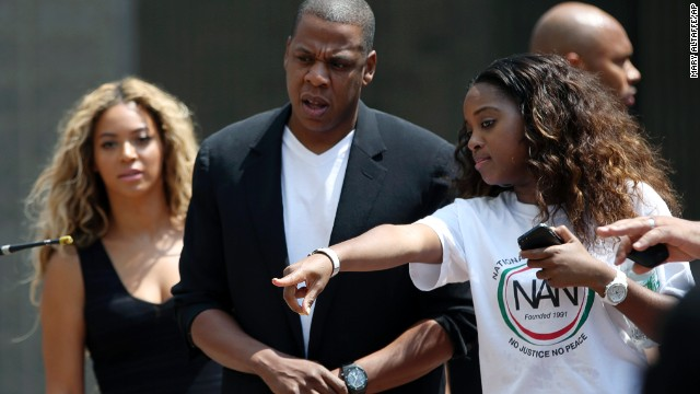 Beyoncé, left, and Jay-Z, center, arrive at the rally in New York City on July 20.