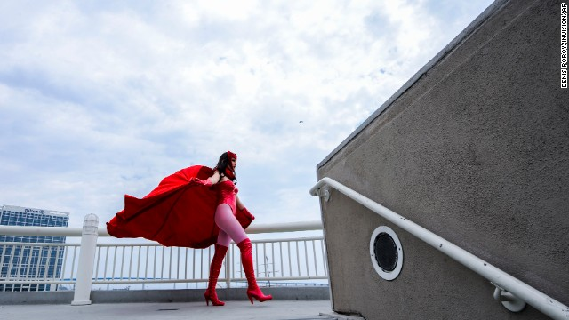 Gillian Owen, dressed as fictional comic book character Scarlet Witch, poses on a walkway during a photo shoot with another photographer on Day 4 of Comic-Con on July 20.
