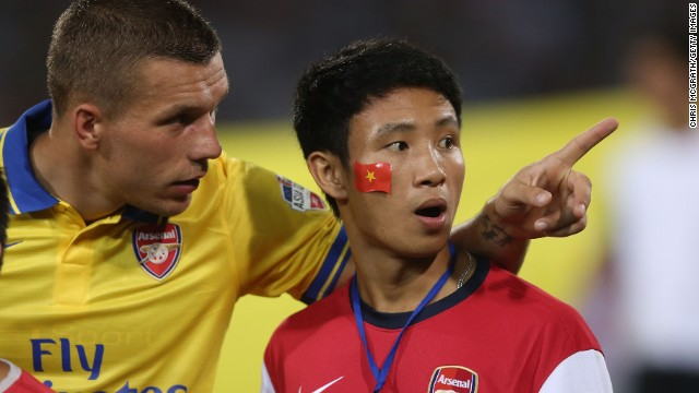 Vu Xuan Tien became Arsenal's unofficial mascot on the Hanoi leg of their pre-season Asia tour after he ran alongside the team's coach for several miles. Tien was then invited to lead the Arsenal players onto the pitch at the My Dinh stadium in Hanoi before their match against the Vietnamese national team, which they won 7-1.