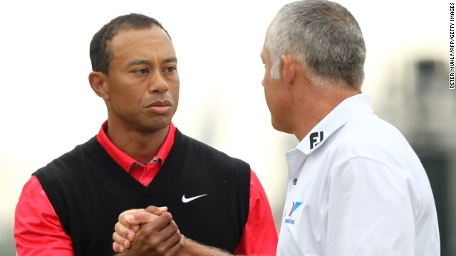 The wait goes on for a first major since 2008 for Woods but his weekend ends on a positive note as he shakes hands with former caddie Steve Williams at the 18th.